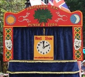 Mr Punch, Punch and Judy, puppet, puppet show, puppetry, Miraiker, Miraiker's World of Puppets, puppet maker, carved puppet, wooden puppet, Punch and Judy booth, puppet booth, aluminium booth, aluminium frame, next show clock, curtains, proscenium, proscenium arch